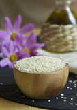 Sesame seeds. Sesame in a wooden bowl for cookery. It is used for a breading and as ingredient in salads. It is useful the content of calcium and antioxidants Stock Photo