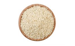 Sesame seeds in wooden bowl isolated on white background. Spices and food ingredients royalty free stock images