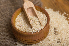 Sesame seeds in  a wooden pot Royalty Free Stock Images