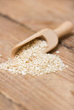 Sesame seeds in  a wooden scoop Royalty Free Stock Images