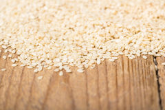 Sesame seeds on a wooden trencher Royalty Free Stock Images