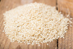 Sesame seeds on a wooden trencher Stock Photo
