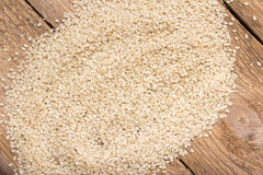 Sesame seeds on a wooden trencher Royalty Free Stock Photography