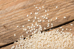 Sesame seeds on a wooden trencher Royalty Free Stock Photos