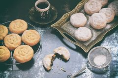 Sesame shortbread with date stuffing. Middle Eastern cookies. Eid and Ramadan Dates Sweets. Kahk. Arabian cuisine. Copy Space royalty free stock photos