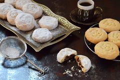 Sesame shortbread with date stuffing. Middle Eastern cookies. Eid and Ramadan Dates Sweets. Kahk. Arabian cuisine. Copy Space stock images