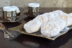 Sesame shortbread with date stuffing. Middle Eastern cookies. Eid and Ramadan Dates Sweets. Kahk. Arabian cuisine. Copy Space.  stock photography