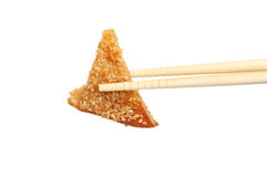 Sesame toast in chopsticks Royalty Free Stock Images