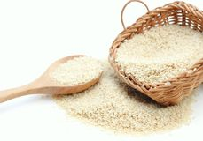 Sesame. In wooden basket with spoon Royalty Free Stock Photos