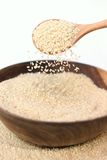 Sesame. In wooden basket with spoon Stock Photo