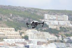 White quadcopter drone. Sesimbra, Portugal, July 11, 2018: White quadcopter drone with photo camera over the sea. Close-up on a white quadcopter drone hovering stock photos