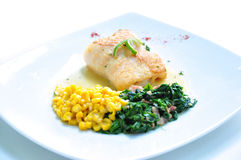 The sesoning fillet fish steak. With corn and spinat Royalty Free Stock Photo