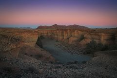 Sesriem Canyon, a natural gorge carved by the powerful Tsauchab River millions of years ago. Sunset royalty free stock photos