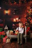 Sessão do Natal de um menino no estúdio fotos de stock royalty free
