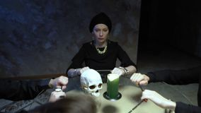 A session of spiritualism group of people sitting at a round table holding hands
