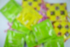 Sesso della sfuocatura dei preservativi Fotografia Stock