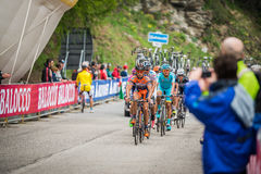 Sestriere, Italy 30 May  2015; Group of Professional Cyclists tackles the last climb before arriva. L of  a stage of the Tour of Italy 2015. Hard stage mountain Royalty Free Stock Photo