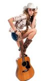 Sesy cowgirl in cowboy hat with acoustic guitar Royalty Free Stock Images