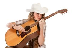Sesy cowgirl in cowboy hat with acoustic guitar Stock Photography