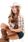 Sesy cowgirl in cowboy hat with acoustic guitar Royalty Free Stock Photos