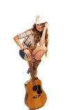 Sesy cowgirl in cowboy hat with acoustic guitar Stock Photo