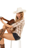 Sesy cowgirl in cowboy hat with acoustic guitar Stock Photos