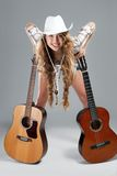 Sesy cowgirl in cowboy hat with acoustic guitar Royalty Free Stock Photography