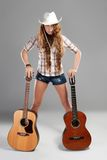Sesy cowgirl in cowboy hat with acoustic guitar Royalty Free Stock Photo