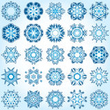 Set of 25 a six-rays crystal gradient snowflakes. Vector illustration on light blue background Stock Image
