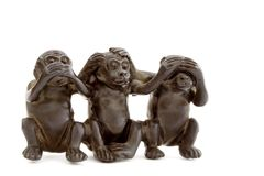 Set of 3 ebonite monkeys. The set of 3 ebonite monkeys Stock Images