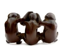 Set of 3 ebonite monkeys. The set of 3 ebonite monkeys Stock Photo