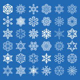 Set of 36 vector snowflakes. Set of 36 vector snowflakes on blue background Stock Photo