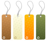 Set of 4 tags with recycling icons. Set of 4 colored product tags with recycling icon symbols Royalty Free Stock Image