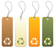 Set of 4 tags with recycling icons. Set of 4 colored product tags with recycling icon symbols Royalty Free Stock Photos