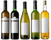 Set 5 bottles with white labels Royalty Free Stock Photography