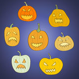 Set of 7 Halloween carved pumpkins. On dark blue background. Objects grouped and named in English. No mesh and transparency used. Gradient used in the Stock Photography