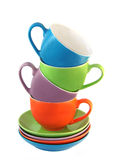 Set. Of amusing ware: multi-coloured cups and saucers Stock Images