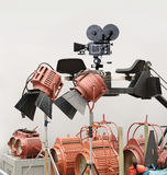 On the Set. Vintage movie crane with movie camera, lights and assorted cinematic gear Royalty Free Stock Photo
