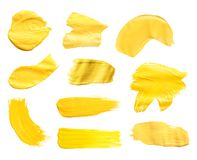Set with abstract brushstrokes of yellow paint on white background. Top view vector illustration