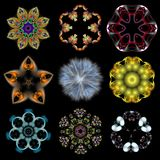 Set of abstract colored patterns on black isolated background. Fractal pattern. Kaleidoscope. Mandala Royalty Free Stock Photos