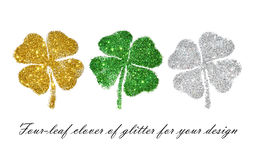Set of abstract four-leaf clovers of green, golden and silver glitter for your design Stock Photography
