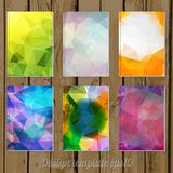 Set of Abstract geometric colorful cover designs from triangular. Faces on wooden background stock illustration