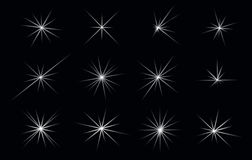 Set of Abstract Lighting Shining Flares or Stars. EPS 10 Stock Photo