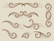 Set of abstract scroll ornaments. Set of decorative abstract ornaments and symmetry Stock Photos