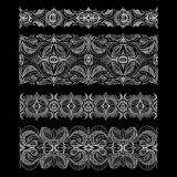 Set of abstract seamless embroidery lace ribbons. Set of abstract seamless embroidery lace borders with hatch at black background royalty free illustration