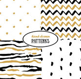 Set of abstract seamless patterns in gold, white and black Royalty Free Stock Images