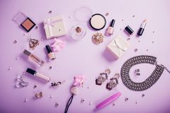 Set of accessories and cosmetics available for sale on Black Friday. Set of accessories and cosmetics on purple background available for sale on Black Friday Stock Photos
