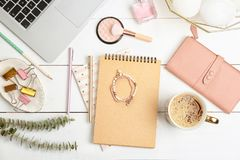 Set of accessories, cosmetics and laptop on wooden background, flat lay. Beauty blogging stock images