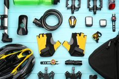 Set of accessories for cycling. On wooden background Royalty Free Stock Photos