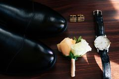 A set of accessories for the groom in dark colors stock image